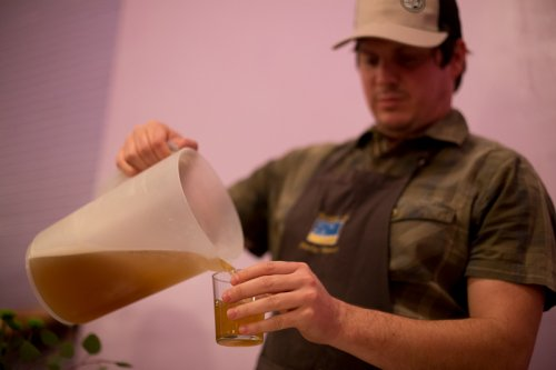 Paul taking his turn pouring beer