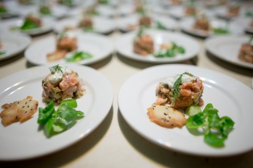 """salmon tartare - """"fresh and smoked salmon drizzled with dill creme fraiche and served with a savory tuile"""""""