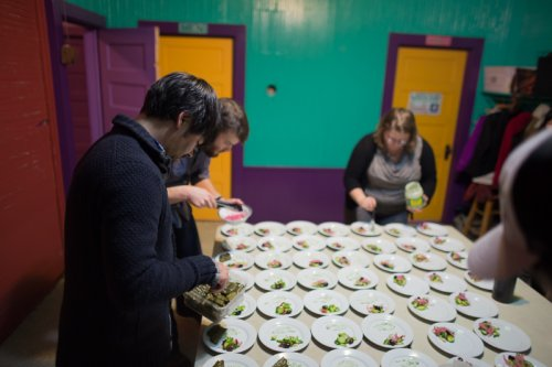 """plating the greek meatballs and dolmades - """"lamb meatball rolled in hazelnut flour, rice and herbs in grape leaves, tzatziki yogurt sauce"""""""