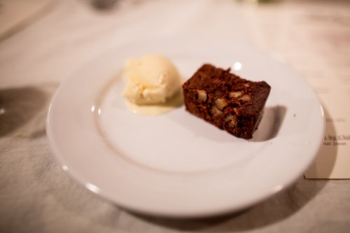 "truffle brownie & vanilla ice cream - ""chocolate-walnut brownie topped with chocolate-coffee ganache and vanilla ice cream"""