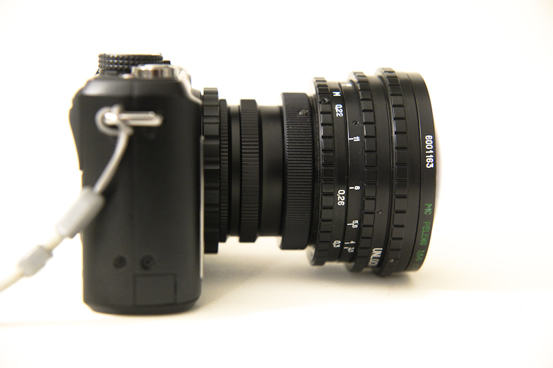 peleng 8mm f/3.5 fisheye mounted on a panasonic gf1, side view