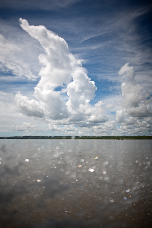 clouds and water spray over the napo river