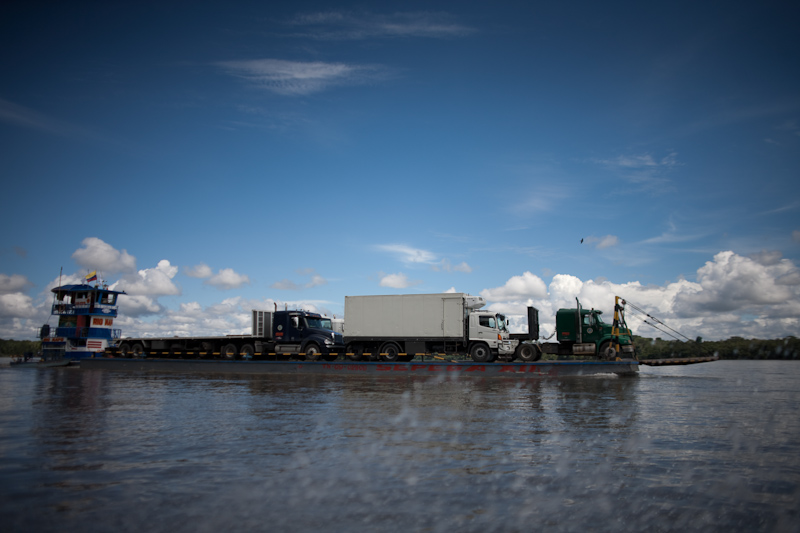 oil trucks on a barge on the napo river